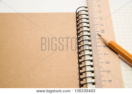 Opened Notebook, Penci And Wooden Rulerl On Over White