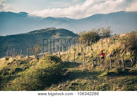 Mountain Bike Rider On Single Track Trail In Inspirational Landscape