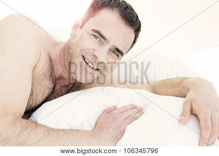 Shirtless Man In Bed And Smiling
