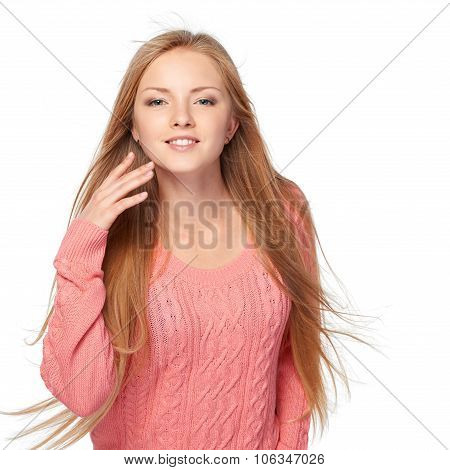 Woman with hair lightly fluttering in the wind
