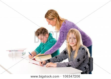 Girl And Boy With Teache Together In The Classroom