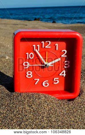 Clock on the Sand Beach