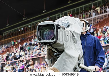Cameraman Opposite The Racecourse Grandstand