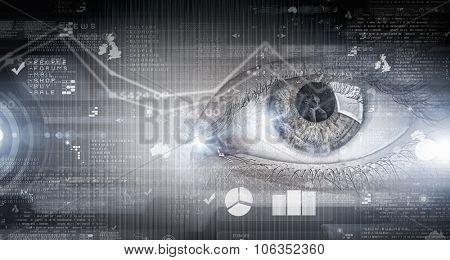 Close up of human eye on digital technology background