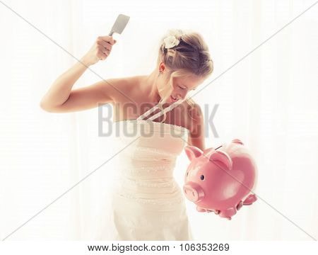 Angry bride with knife in hand about to smash piggy bank