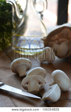 Various Mushrooms Placed On A Wooden Table