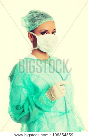 Female surgeon doctor with a scalpel.