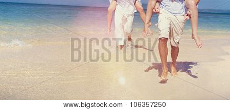Couple Relaxing Beach Carrying Summer Leisure Concept