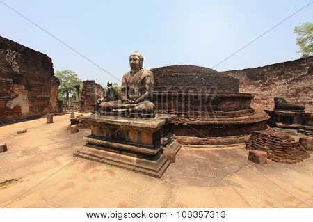 Ancient Buddha Statue Of Temple Ruins In Ancient City Of Polonnaruwa
