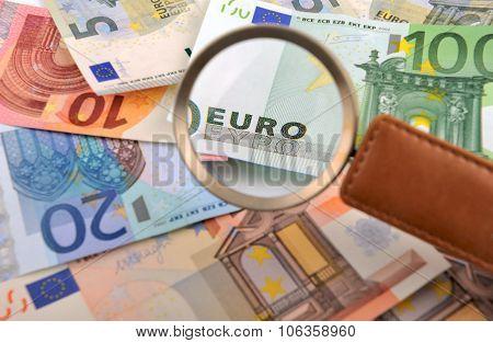 Caption EURO through a magnifying glass