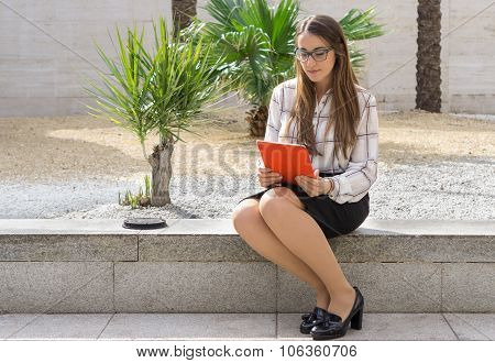 Office woman working on park with tablet