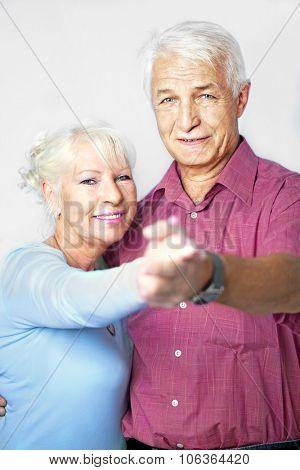 Senior couple dancing together, front view