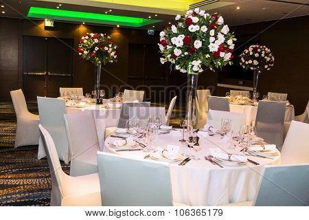 Wedding Banquet  Hall In Shades Of White With  Beautiful Flowers In Vases