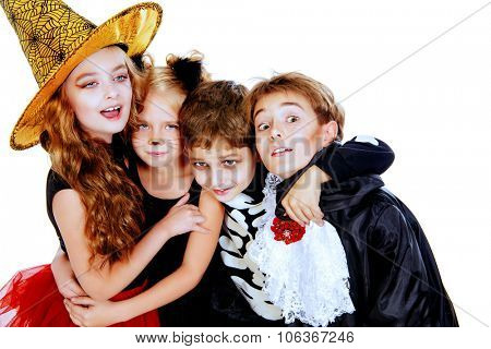 Portrait of a cute laughing children in halloween costumes. Halloween concept. Isolated over white.