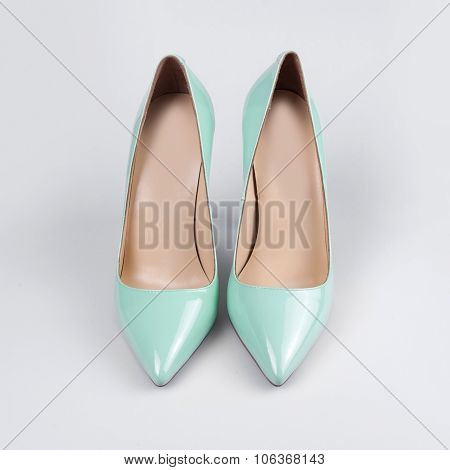 Ladies stylish patent leather shoes over white