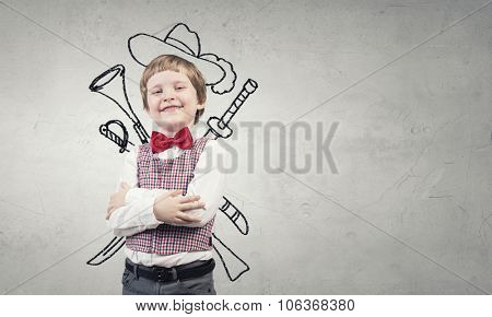 Portrait of young boy with drawn hat and guns behind his back
