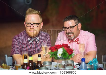 Gay Couple Drinking Wine