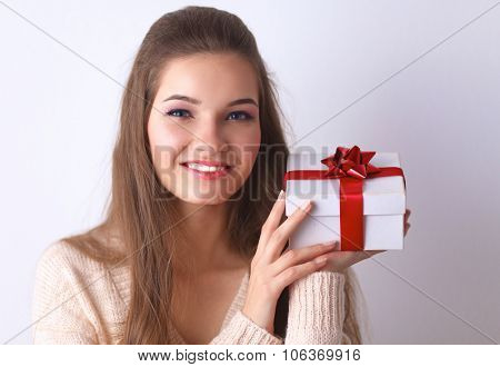 Young woman happy smile hold gift box in hands