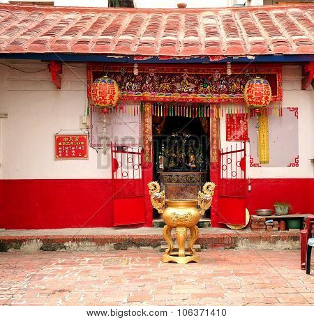 Small Chinese Temple In A Local Neighborhood