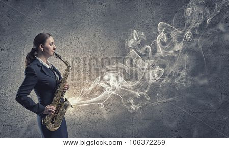 Young pretty woman in suit playing saxophone