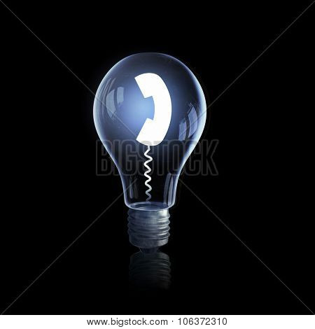 Glass light bulb with call sign on black bakground