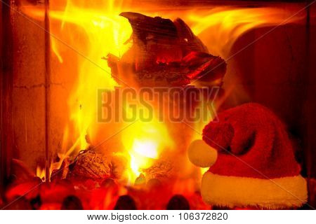 Flames of fire in a fireplace and Santa hat.