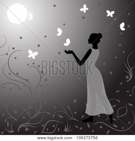 Girl clothed in gauzy dress in night with butterflies