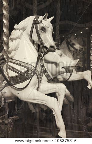 White horse in a carousel at the fair.  Cross processed and texture to look like and instant picture.