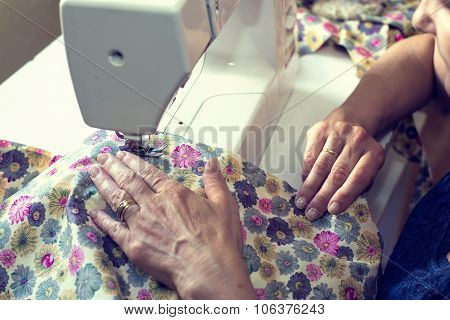 Middle Aged Woman Working With A Sewing Machine