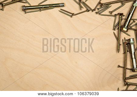 Gold screws on top and right with wood background