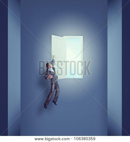 Businessman hanging on the open door