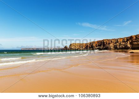 Coastline with waves of the sea on the sandy summer beach, Portugal