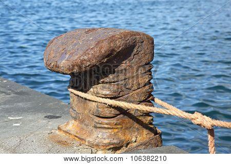 Old Bollard On The Dock