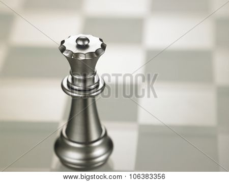chess piece Queen on the glass chess board