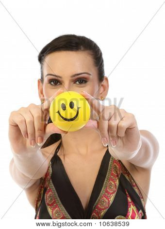 Teenage girl with yellow smile ball