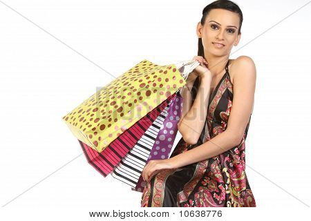 Teenage girl with lots of shopping bags