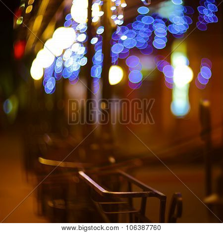 Blurred Night Lights Decorations Of The Bar On  Background