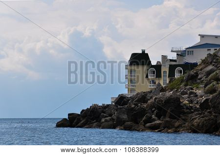 Hotel On The Sea Coast In The Evening