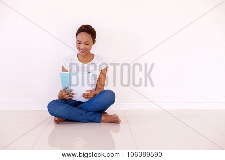 gorgeous young african american college student studying at home