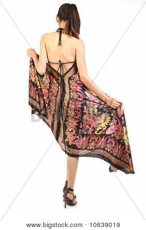 Woman with long dress turning backwards