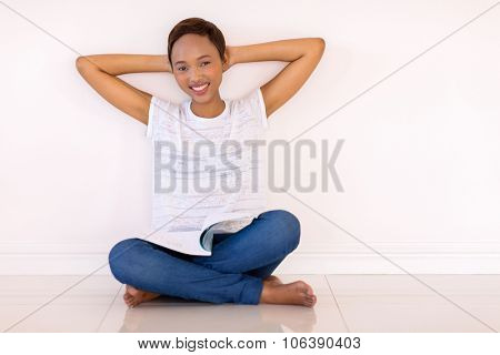 happy african american university student studying at home