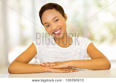 portrait of happy afro american woman relaxing at home