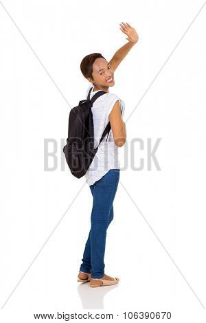 pretty african college student waving goodbye isolated on white background