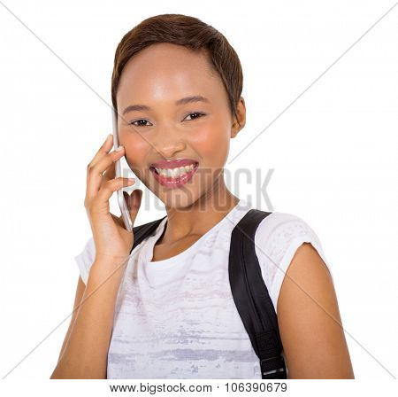 portrait of cheerful african american college girl talking on mobile phone