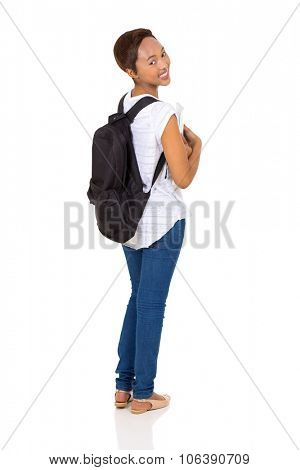 cheerful young african college girl looking back on white background