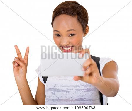 happy african college student taking a selfie with smart phone camera