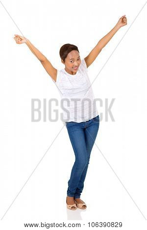 excited young afro american woman with arms up