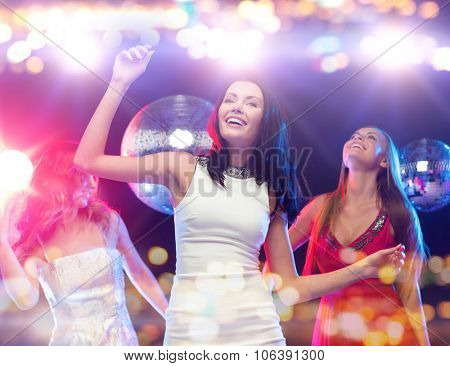 party, celebration, holidays, nightlife and people concept - happy women dancing at night club