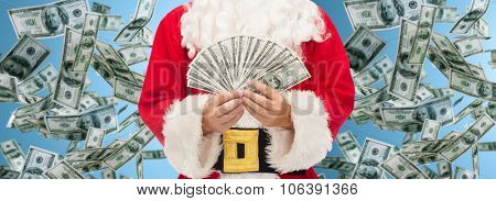 christmas, holidays, winning, currency and people concept - close up of santa claus with dollars over money rain background