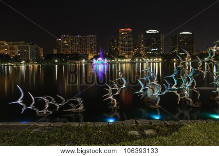ORLANDO, FLORIDA - October 26: Lake Eola In The Night And Sculpture Of Birds